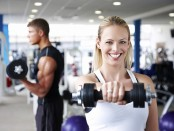 Woman with dumbbells in the gym photo